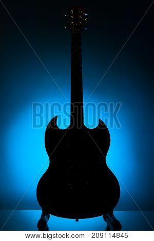 electric guitar silhouette against blue background