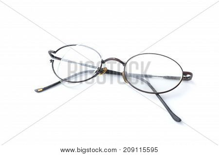 Old glasses with broken brown lens and frame isolated on white background