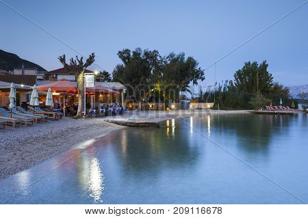 NYDRI, GREECE - OCTOBER 2, 2017: Seafront of Nydri village on Lefkada island in Greece on October 2, 2017.