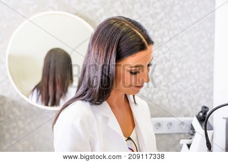 A female Doctor in the consultation room