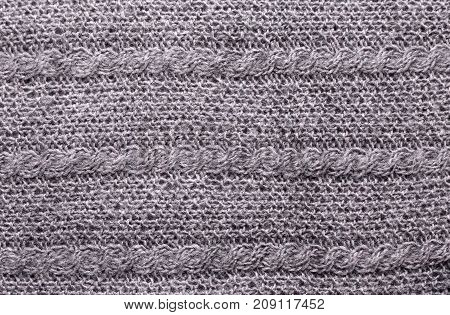 Gray knitting wool texture. Warm handmade background