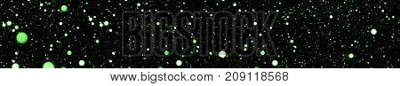 abstract background panorama. green blurred bokeh on a black background panoramic view. design element holiday new year and christmas