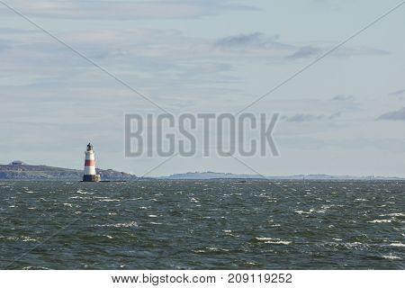 Lighthouse on the sea at sunny day - horizontal shot