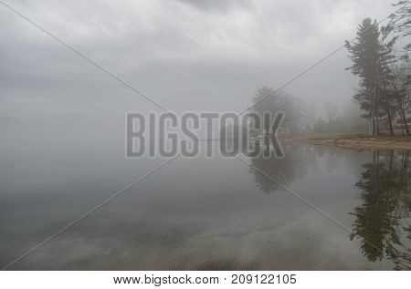 Foggy Morning Tree Reflections on the Lake