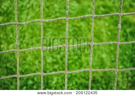 Picture Of Football Net With Green Grass At The Background