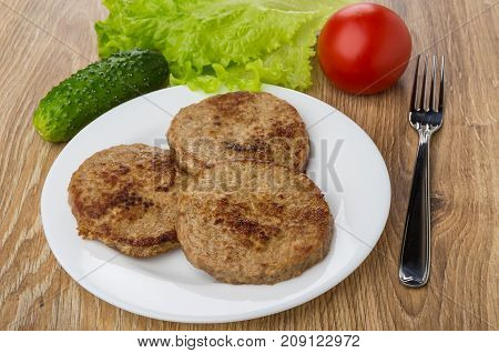 Fried Cutlets In Plate, Leaves Of Lettuce, Tomato, Cucumber