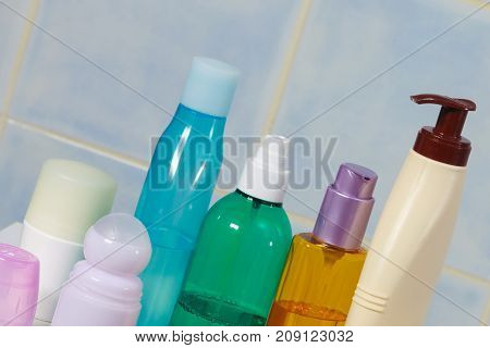 Body and skin carehygiene concept - bottles with liquid soap or lotion cosmetics set in bathroom