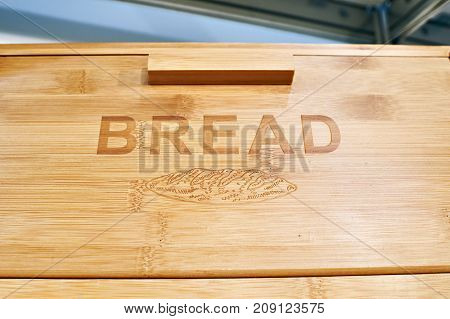 The wooden breadbasket for bread with text