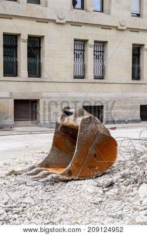 Backhoe bucket of an excavator at a demolition construction site