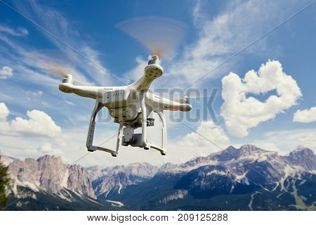 drone copter flying with camera in mountains