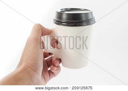 mockup of coffee paper cup, hand holding coffee paper cup isolated on light grey background