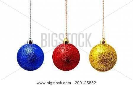 Hunging red blue and yellow christmas ball isolated on a white background