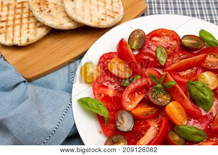 Tomato salad Traditional Italian salad of tomatoes and basil