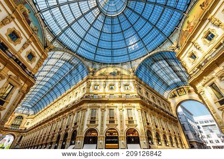 Milan, Italy - May 16, 2017: Inside the Galleria Vittorio Emanuele II on the Piazza del Duomo in central Milan. This gallery is one of the world's oldest shopping malls.
