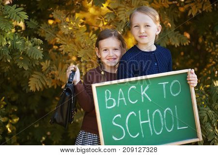 Two Little Sisters Happy Back To School