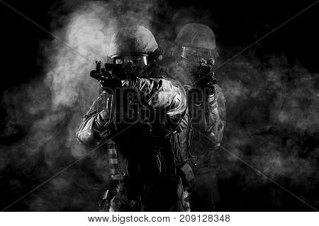 American Soldiers In Combat Ammunition With Weapons In The Hands Of Equipped Laser Sights Are In Bat