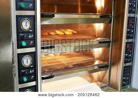 The oven with bread in the bakery