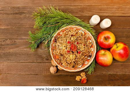 Top View Of A Dish Of Traditional Christmas Dish Slavs - Kutia. Wooden Background Spruce Branch, App