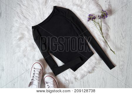 Black Sweater On White Fur, Sneakers. Fashion Concept