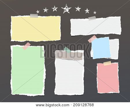 White and colorful ripped striped paper, notebook sheets for note or message stuck with sticky tape on dark background with stars
