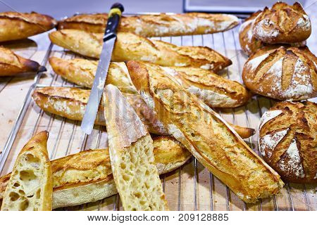 Fresh Baguette Bread With Crust In Bakery