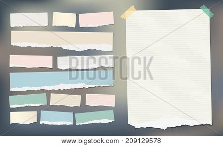 White and colorful ripped striped paper, notebook sheet for note or message stuck with sticky tape
