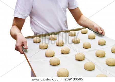 Baker With Tray Of Balls Dough For Baking Buns Isolated