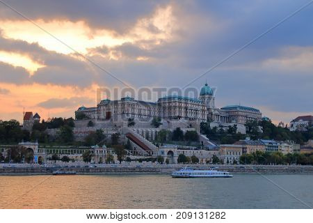 The picture was taken in Budapest. In the photo the fortress of Buda at sunset on a cloudy day.