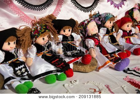 Romanian handmade dolls in traditional costumes in a fair