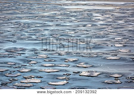 Impressionist  winter round pieces of ice on water