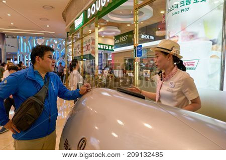 BUSAN, SOUTH KOREA - MAY 28, 2017: information desk at Lotte Department Store.