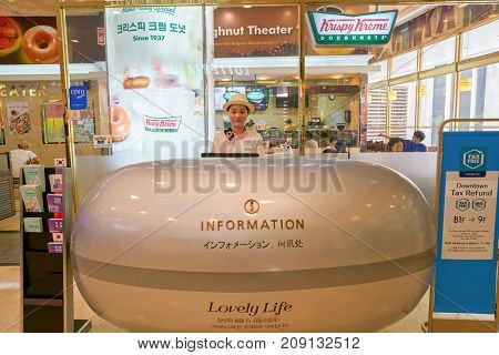 BUSAN, SOUTH KOREA - MAY 28, 2017: staff at Lotte Department Store information desk.