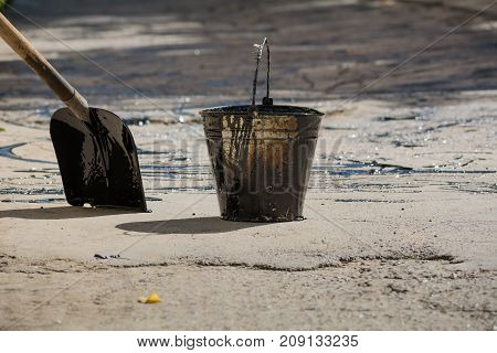 Bucket With Bitumen And Shovel On Road Works