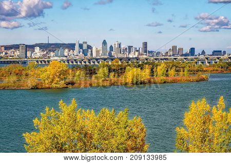 Montreal view from south shore in early fall with clouds
