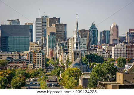 Montreal downtown close up view with trees and buildings