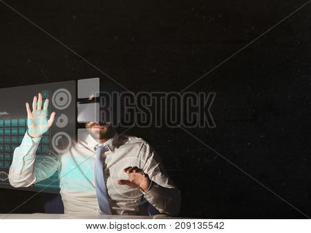 Digital composite of adult man using vr headset interface in dark room