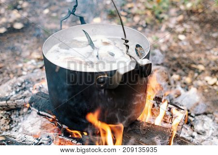 The Process Of Cooking Fish Soup In The Campaign