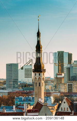 Tallinn, Estonia. Tower Of Tallinn Town Hall On Background Of Modern Architecture. Oldest Town Hall In Baltic Region And Scandinavia.