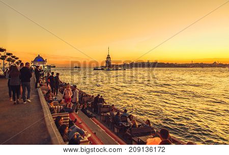 Istanbul Turkey: People are spending leasure time and meeting sunset with view of Maiden's tower in Uskudar on October 11 2017