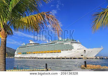 LABADEE, HAITI - APRIL 16, 2017: Royal Caribbean cruise ship Navigator of the Seas docked at the private port of Labadee in the Caribbean Island of Haiti