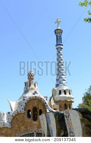BARCELONA - JUN. 10, 2013: Entrance Pavilions at Park Guell Catalan: Parc Güell, Barcelona, Spain. Park Güell is part of the UNESCO World Heritage Site Works of Antoni Gaudi since 1984.