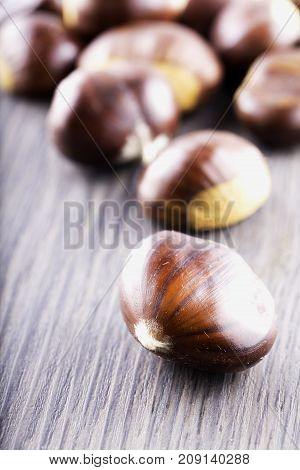 Chestnuts Over Wooden Table