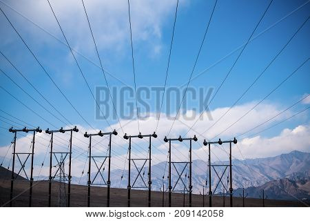 Electric poles and cables with blue sky background in Ladakh city India
