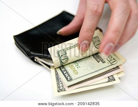 Woman's hand count money in vintage leather purse