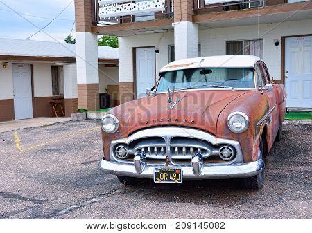 Seligman, Arizona, Usa - July 24, 2017: Rusty abandoned Packard car in Seligman, Arizona.