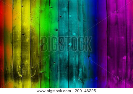 A wood background texture with the colors of the rainbow