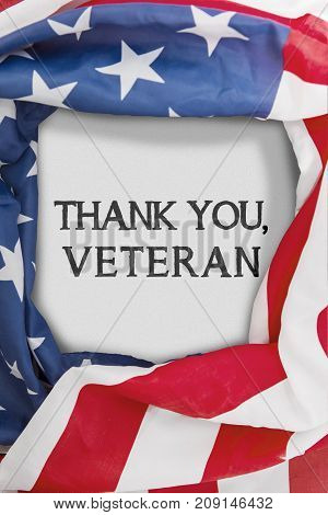 Closeup of American flag shaped a frame with text of thank you veteran on the white background