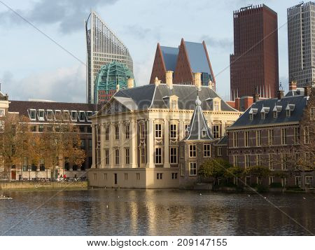 The Hague the Netherlands - 12 October 2017: Mauritshuis museum historic Binnenhof buildings and modern buildings of The Hague in background