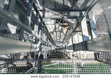 Vertical staircase with guard rail. Industrial abstract background.