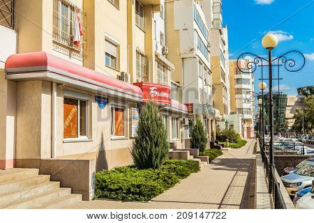 Belgorod Russia - September 29 2017: Narodniy (People's) Boulevard. Residential buildings with local shops and footpath.